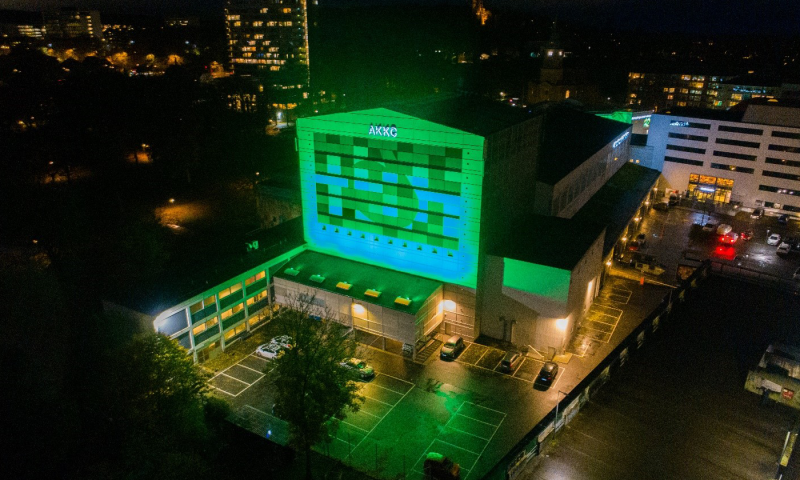In celebration of the partnership, AKKC lit up its iconic building and stage tower in green. Photographer: Jan H. Pedersen