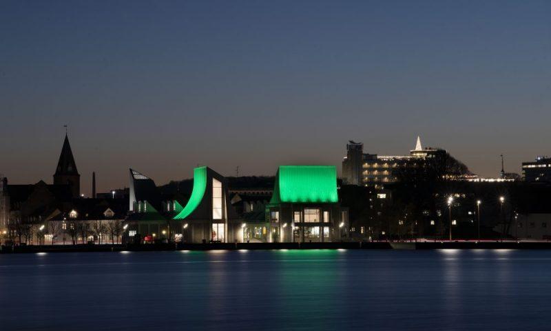 Utzon Center with green light. Photo: © Lars Horn / Baghuset. Date: 26.11.20